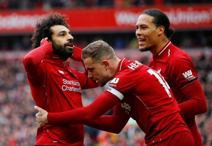 Jordan Henderson (midden) is initiatiefnemer van Players Together. Rechts Mohamed Salah en links Virgil van Dijk.