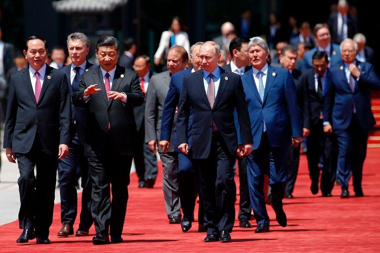 De Chinese president Xi Jinping (3e van links) met de Vietnamese president Tran Dai Quang (L) en president Vladimir Poetin uit Rusland (2e van rechts) in Beijing, 2017. Beeld AFP