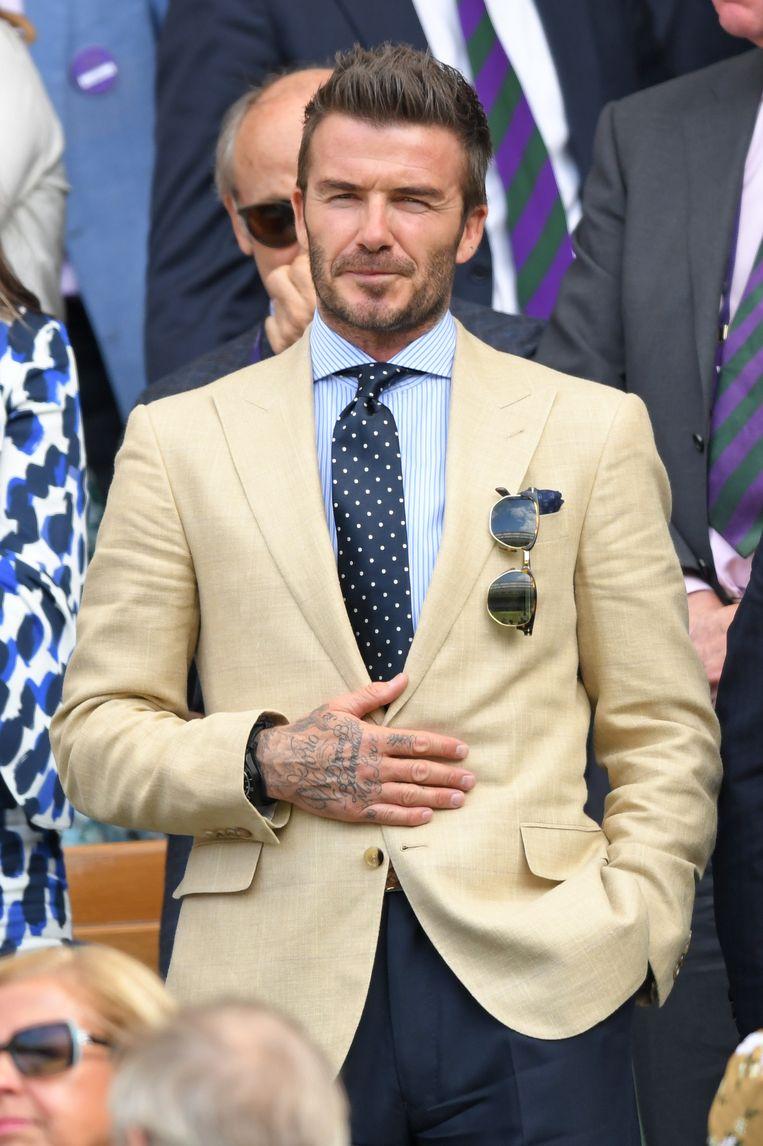 David Beckham zet al z'n spullen op één lijn of in paren van twee.