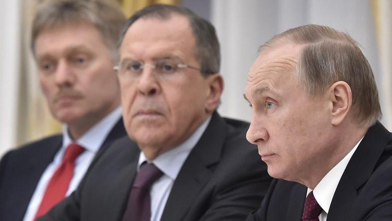 V.l.n.r.: Kremlin-woordvoerder Dmitri Peskov, minister Lavrov van Buitenlandse Zaken en president Poetin, in maart 2016. Beeld epa