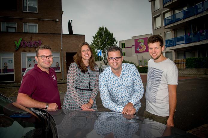 De directie van Yoast, met op de achtergrond twee van de vier kantoren. Vlnr: Michiel Heijmans, Marieke van de Rakt, Joost de Valk en Omar Reis.