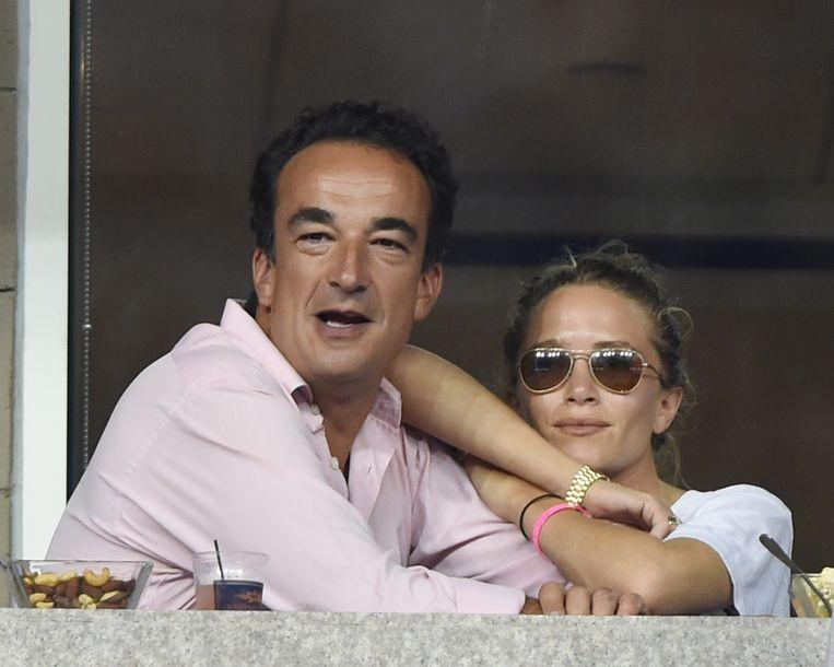 Olivier Sarkozy en Mary-Kate Olsen in 2014.