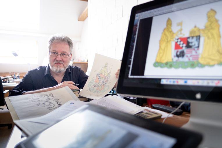 Luc Morjaeu heeft het nieuwe wapenschild van de fusiegemeente Puurs-Sint-Amands ontworpen.