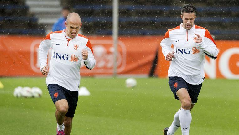 Arjen Robben en Robin van Persie samen op de training Beeld anp