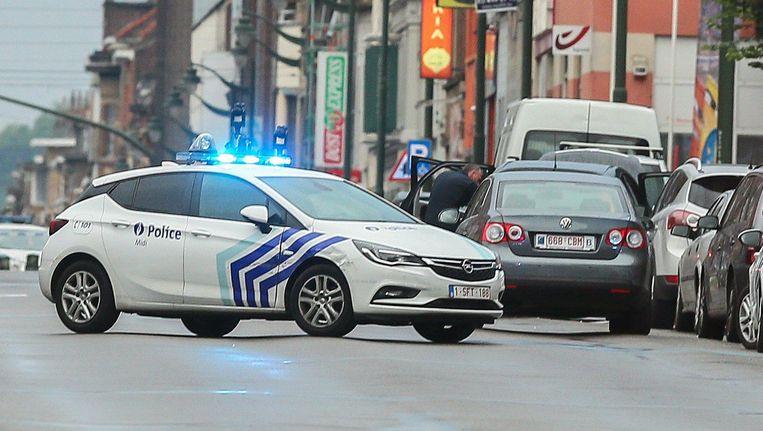 Een politieactie in Molenbeek, de deelgemeente wordt gezien als een draaischijf voor terroristen. Beeld epa