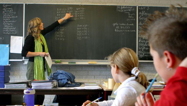 Jaarlijks komen in Amsterdam duizenden kinderen van school die niet goed kunnen lezen en rekenen. Foto ANP Beeld