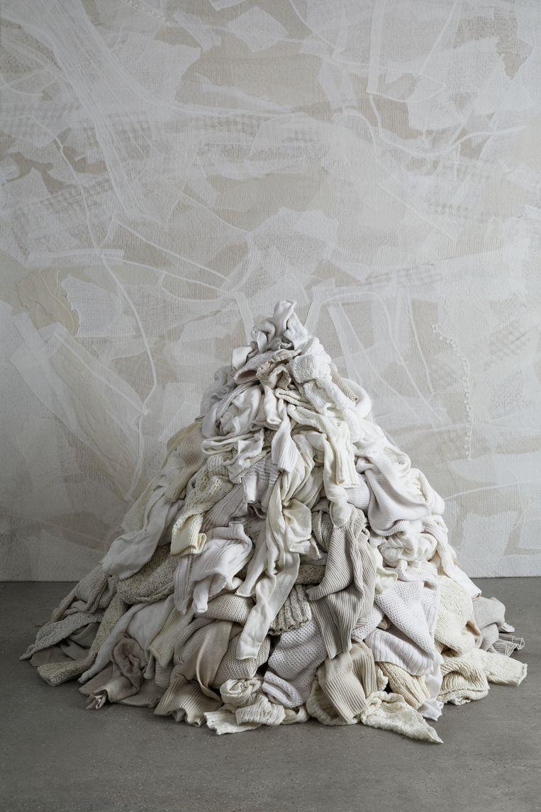 Het 'Waste No More'-initiatief recycled oude kledingstukken van modeontwerper Eileen Fisher tot kussens en wandkleden. Beeld Waste No More