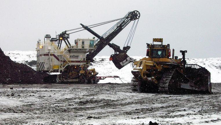 De afgravingen van Shell en partners in de Muskeg River Mine nabij oliestadje Fort McMurray in noordelijk Alberta (Canada). Beeld anp