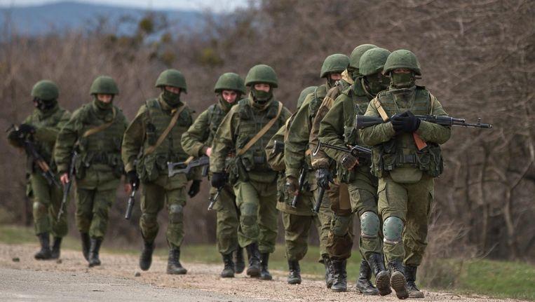 Pro-Russische soldaten op de Krim in het voorjaar van 2014. Rusland annexeerde het schiereiland dat jaar. Beeld ap