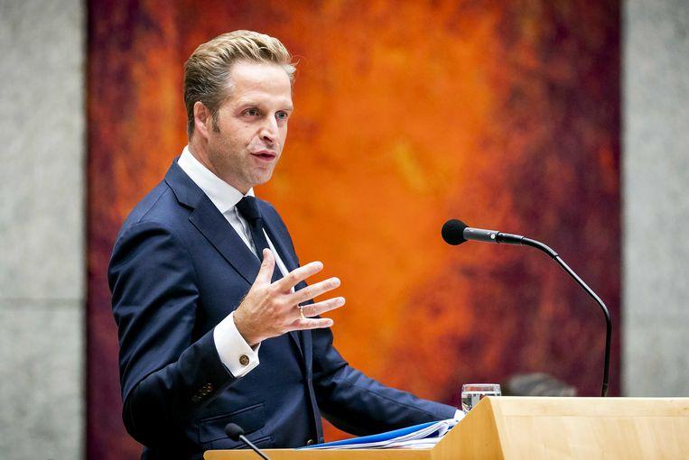 Minister Hugo de Jonge van Volksgezondheid tijdens een debat in de Tweede Kamer over de aanpak van de coronacrisis.  Beeld ANP/Sem van der Wal