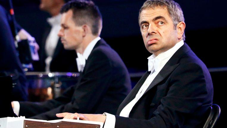 Mr. Bean achter zijn piano in de olympische arena. Beeld REUTERS