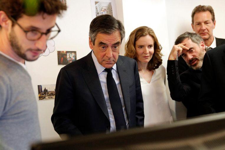 François Fillon woensdag op het hoofdkantoor van muziekstreamingdienst Deezer. Beeld epa