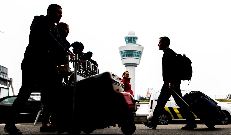 Reizigers van luchthaven Schiphol.