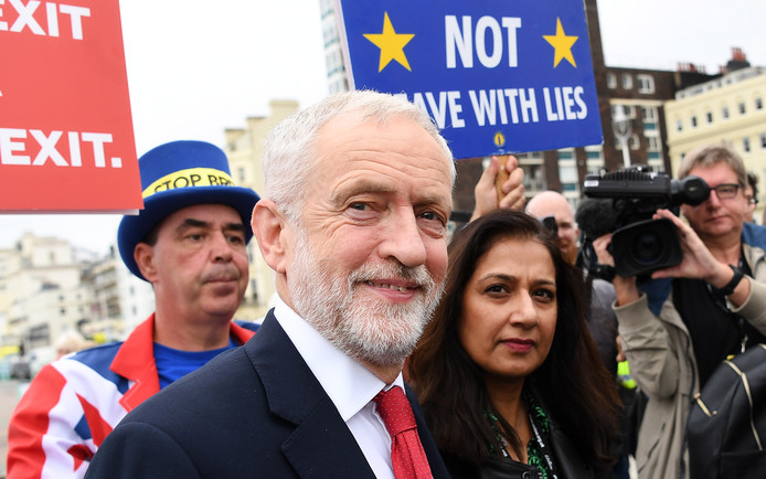 epa07860462 Britain's Labour Party leader Jeremy Corbyn (C) departs the Andrew Marr Show on the second day of the Labour Party Conference in Brighton, Britain, 22 September 2019. The Labour Party Conference runs from 21 to 25 September.  EPA/ANDY RAIN