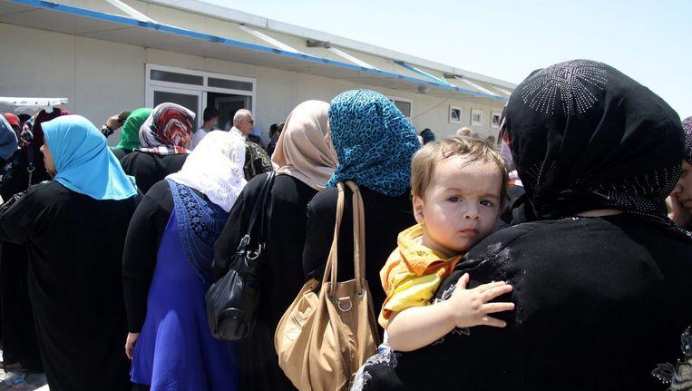 Gevluchte Irakezen uit Mosul in Erbil, Noord-Irak. Beeld null