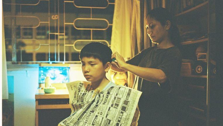 Een fragment uit de film Ilo Ilo: een verstikkende, bitter-komische en aangrijpende hommage aan Anthony Chens volhardende jeugdheldin. Beeld -