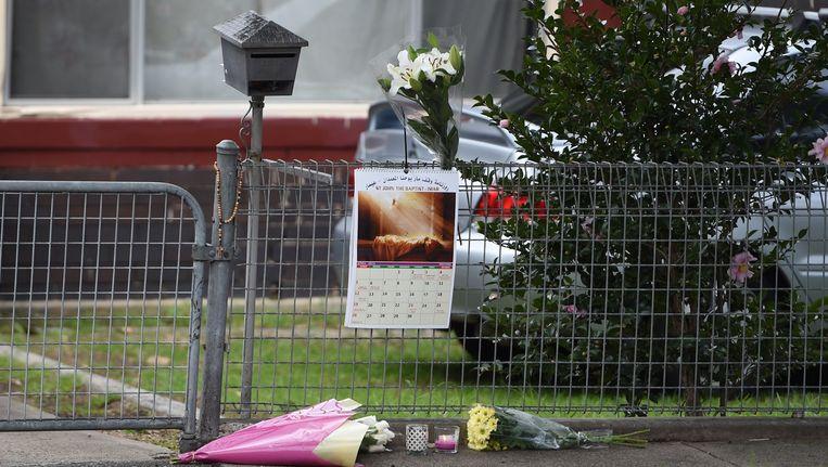 Bloemen bij het huis van de ter dood veroordeelde Australiër Andrew Chan Beeld null