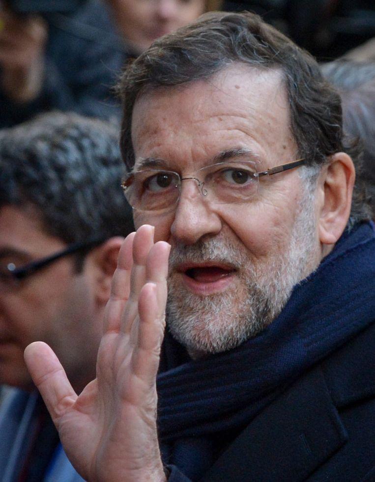 Premier Rajoy ontkende aanvankelijk te hebben afgeweten van de zwarte partijkas van zijn partij. De Partido Popular kende vijftien jaar lang een zwarte boekhouding. Beeld epa