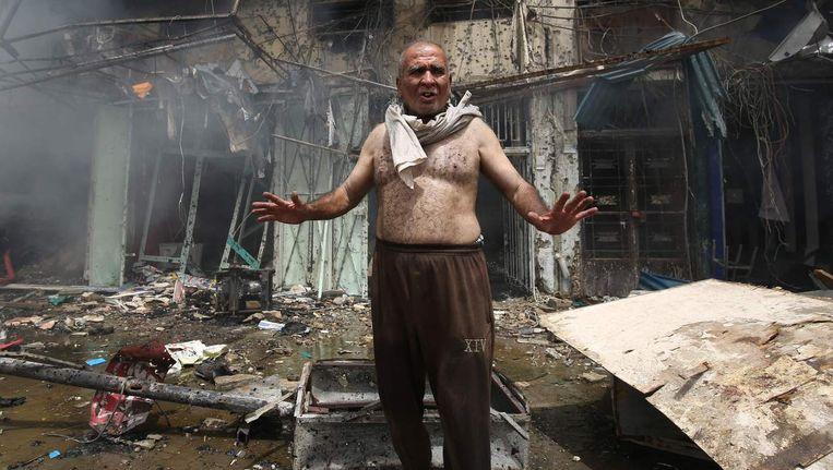 Ravage vorige week in Baghdad, nadat in de wijk Baghdad Jadida een autobom ontplofte. Beeld afp