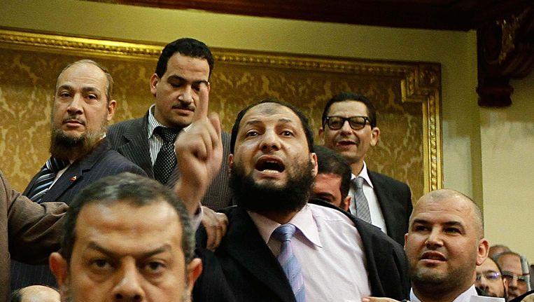 Anwar al-Balkimy (midden). Beeld AP