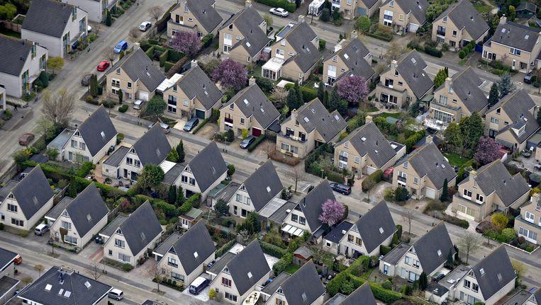Honderdduizenden huizenbezitters in Nederland kunnen substantieel kosten besparen door over te stappen naar een andere hypotheekaanbieder. Beeld Raymond Rutting / de Volkskrant