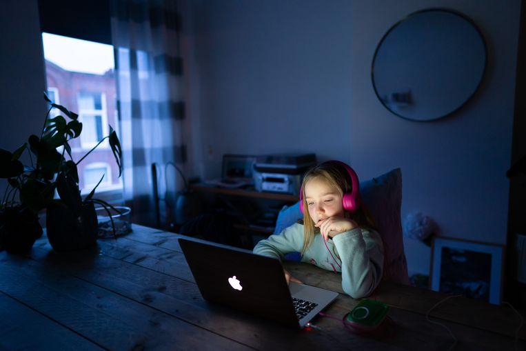 Een leerling thuis aan het werk voor school. Voor zogeheten thuiszitters kan die situatie juist voordelig werken. Beeld ANP