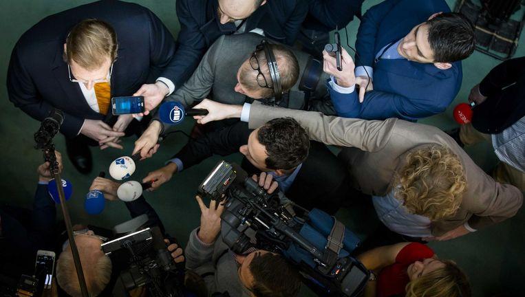 Minister Van der Steur (linksboven) staat dinsdag in Den Haag de pers te woord. Beeld anp