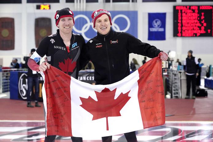 Ted-Jan Bloemen en Graeme Fish na de rit de rit op de 10.000 meter.