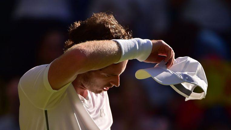 Andy Murray tijdens zijn wedstrijd tegen Mikhail Kukushkin op de tweede dag van Wimbledon. Beeld afp