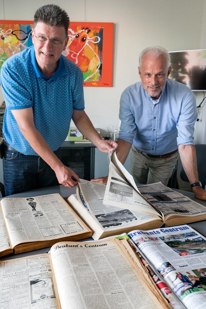 Henk van Weer (links) en Henk van der Zee met leggers vol jaargangen Brabants Centrum.
