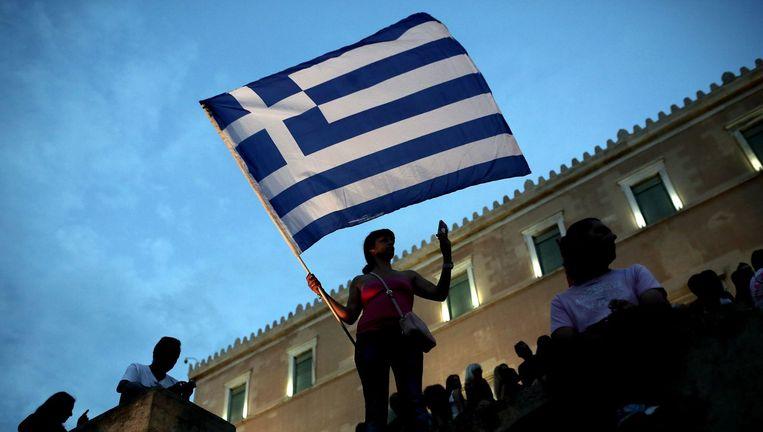 Een demonstrant in Athene protesteert tegen verdere bezuinigingsmaatregelen voor Griekenland. Beeld afp