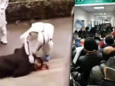 Zorgwekkende beelden uit 'spookstad' Wuhan: mensen bewusteloos op straat, chaos in ziekenhuizen