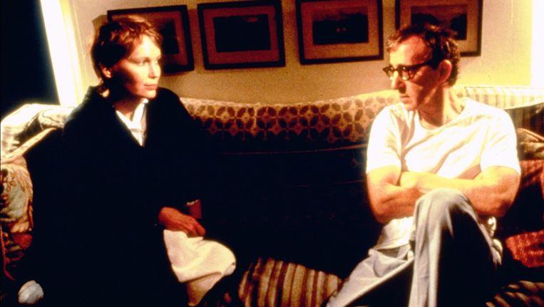Mia Farrow en Woody Hallen, begin jaren negentig. Beeld anp