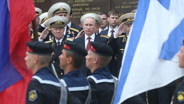 De Russische president Vladimir Poetin tijdens een militaire parade.