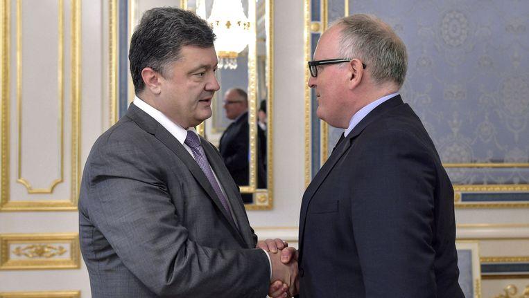 De Oekraïense president Petro Porosjenko ontmoet minister Frans Timmermans (buitenlandse zaken) in Kiev, 19 juli 2014. Beeld getty
