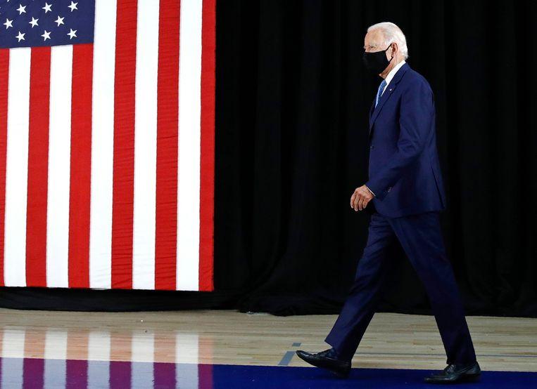 Joe Biden tijdens een toespraak op de Alexis Dupont High School in Delaware in juni.  Beeld AP