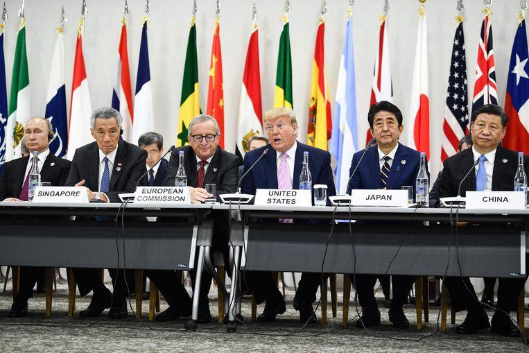 Trump (midden) en Xi (rechts) vanochtend in Osaka. Beeld AFP