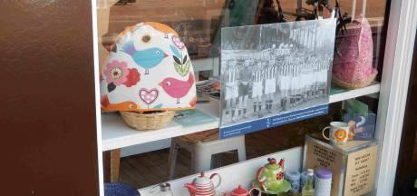 Winkeliers steunen met oude foto's in etalages bedreigd Almelo's Stadsmuseum
