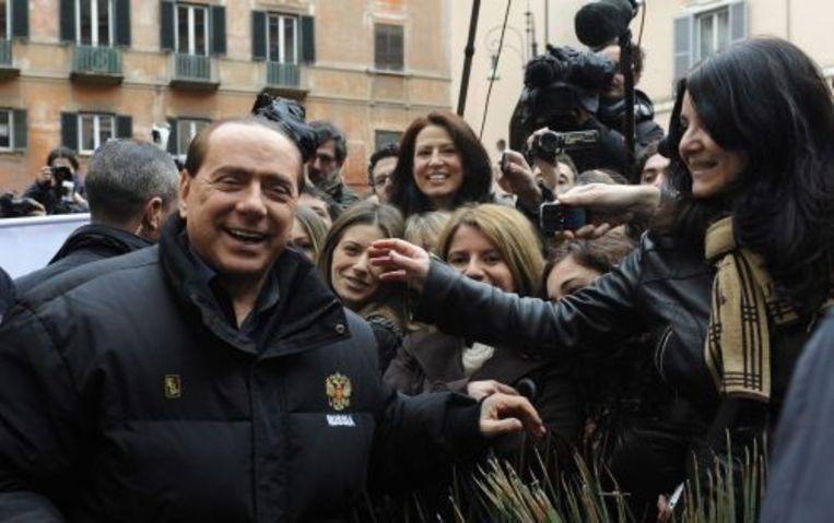Berlusconi keerde maandag terug naar zijn werk in Rome. ANP Beeld