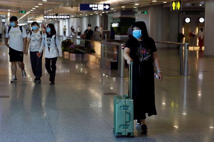Des voyageurs à l'aéroport international de Pékin-Capitale, en Chine (illustration).