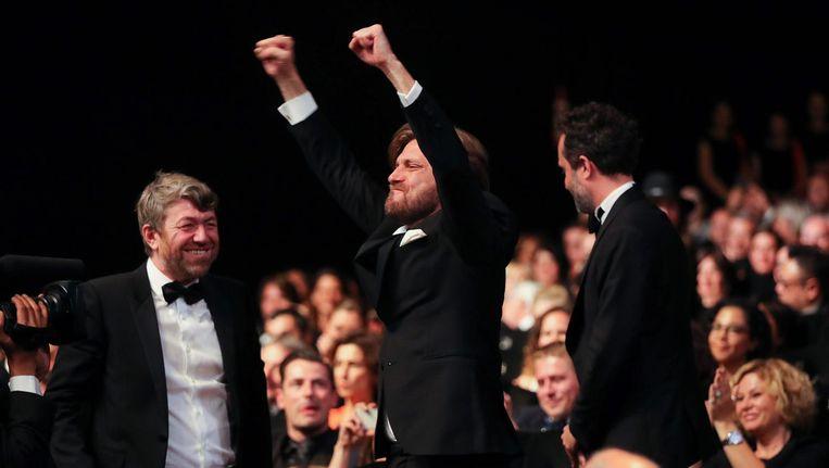 Zweedse regisseur Ruben Östlund na hij de Gouden Palm gewonnen heeft voor zijn film 'The Square' op het Cannes Film Festival. Beeld afp