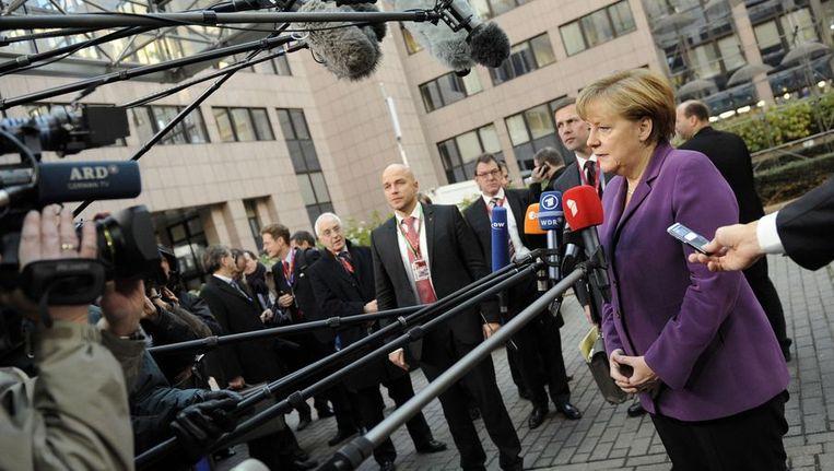 Angela Merkel staat de pers te woord. Beeld afp
