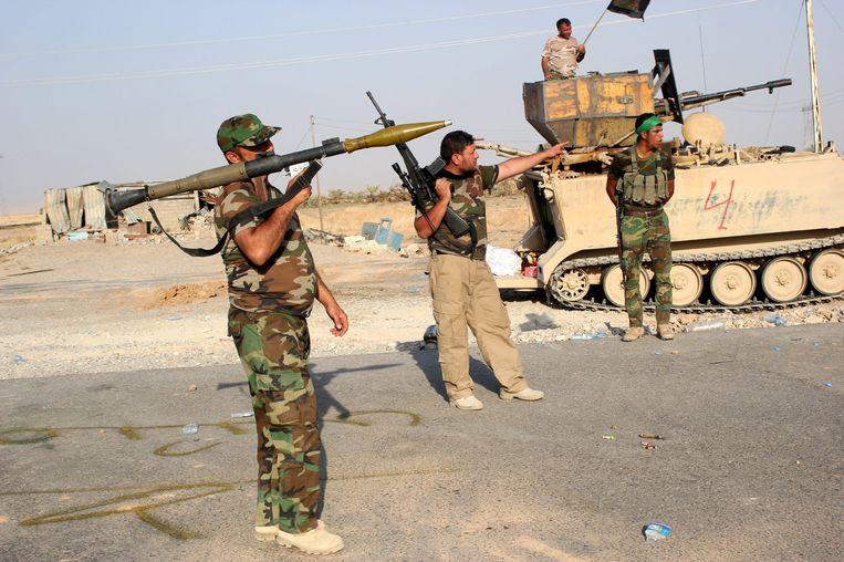 Strijders van de sjiitische Hezbollah-beweging. Beeld EPA