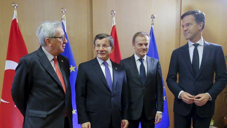 De onderhandelaars Juncker, Davutoglu, Tusk en Rutte vrijdag in Brussel. Beeld reuters
