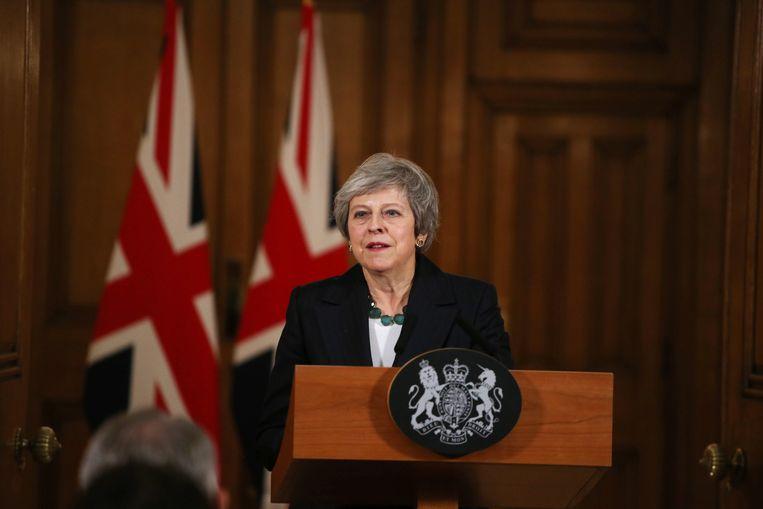 Theresa May tijdens de persconferentie over haar Brexitakkoord op 15 november.  Beeld Getty Images