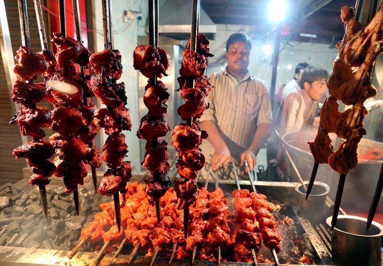 Tandoori kip, nu overal in India verkrijgbaar. Beeld epa