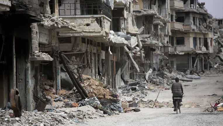 Een verwoeste stad in de provincie Homs Beeld ap