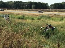 Auto raakt van de weg op A59 bij Empel; een persoon zwaargewond