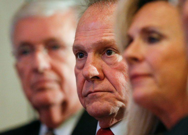 Republikeins senaatskandidaat Roy Moore (midden).  Beeld AP