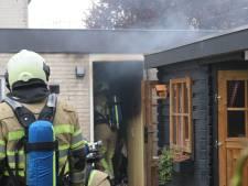 Bewoner ademt rook in bij brand in garagebox in Woudenberg